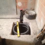 The septic tank set into the basement floor